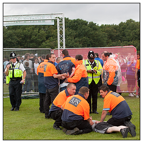 Security detain trouble makers at a festival